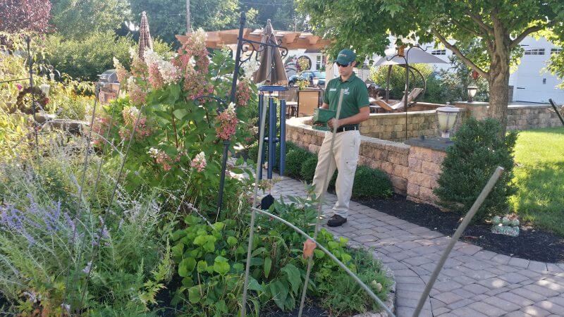 tcpc service tech inspects garden