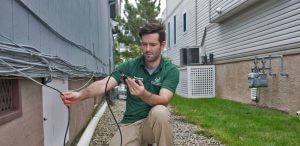 TCPC tech inspecting outside