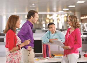 cheesy people chatting in office