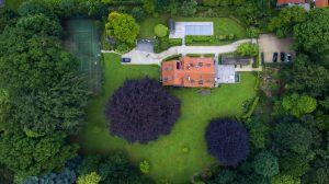 aerial shot of a house in a very green area overhead
